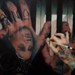 getatoeëerde handen hand-tattoos