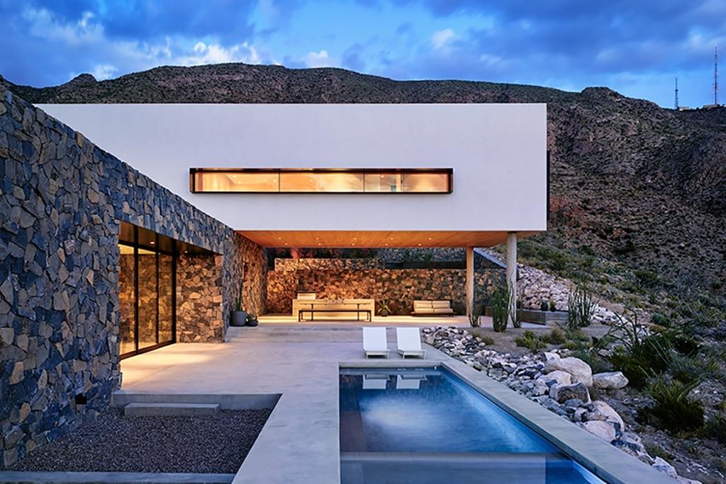 Droomhuis scherpe architectuur tegen woeste heuvel for Interieur architectuur